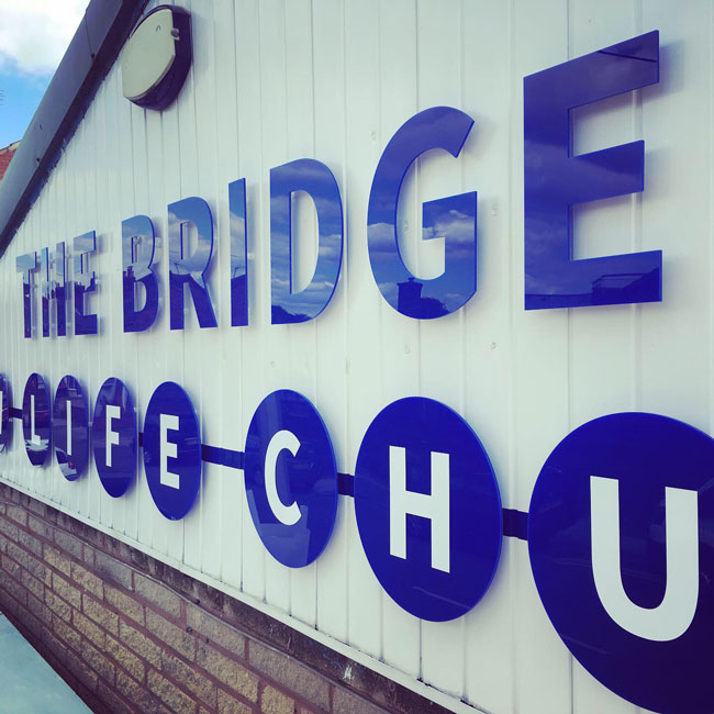 Newly installed acrylic signage for The Bridge Church